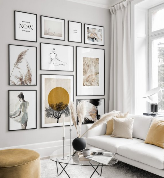 Earthy gallery wall with designposters and black frames